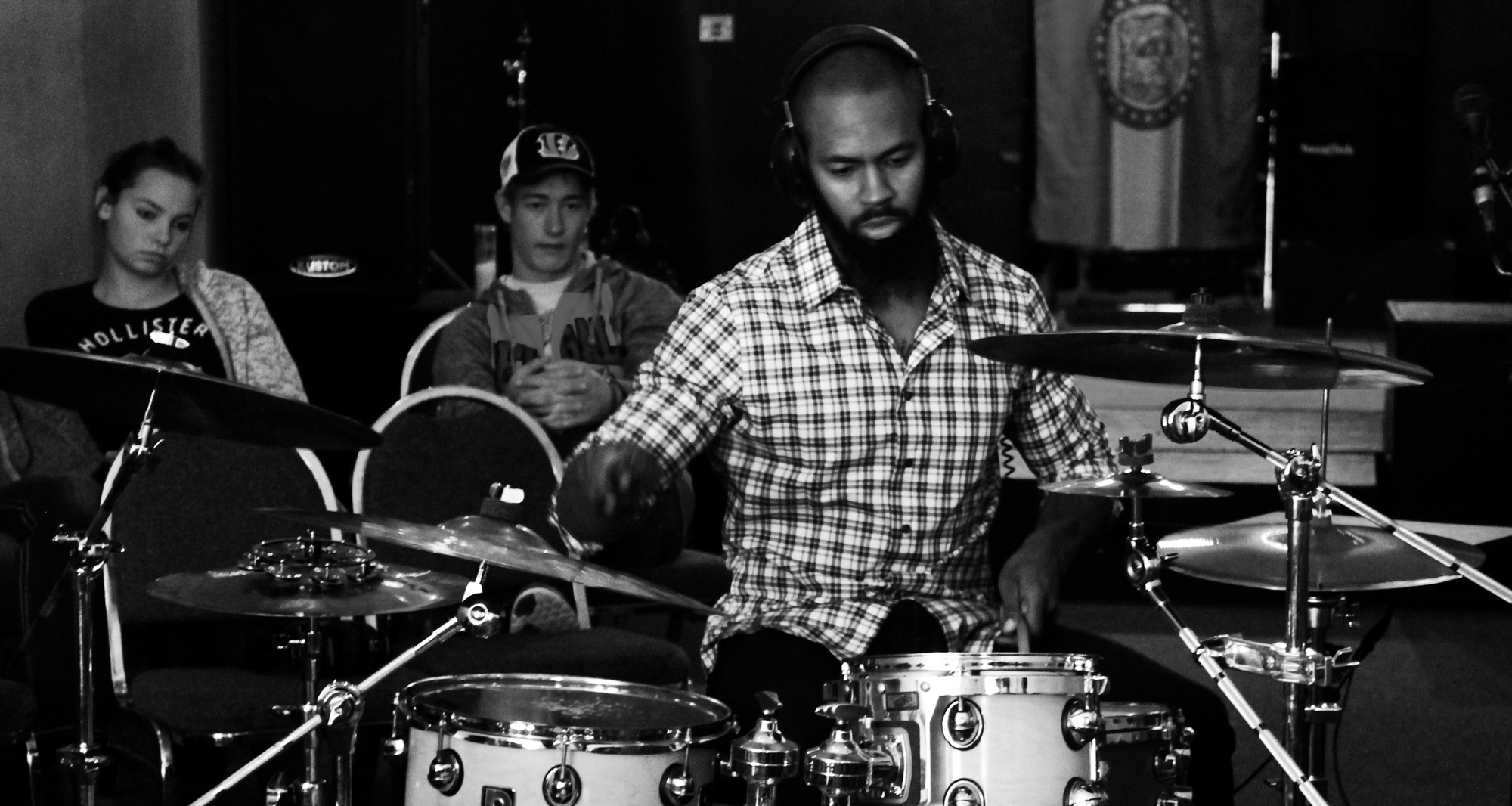 jaron lamar davis drumming at an instructional clinic